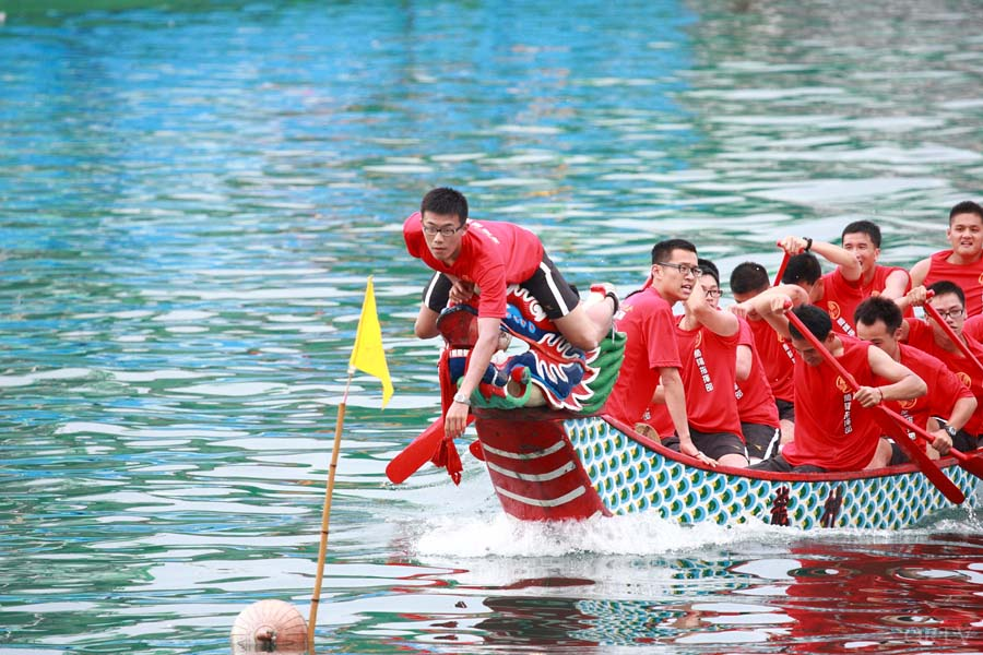 There are 20 paddlers, a drummer, and a steerer in a standard dragon boat.