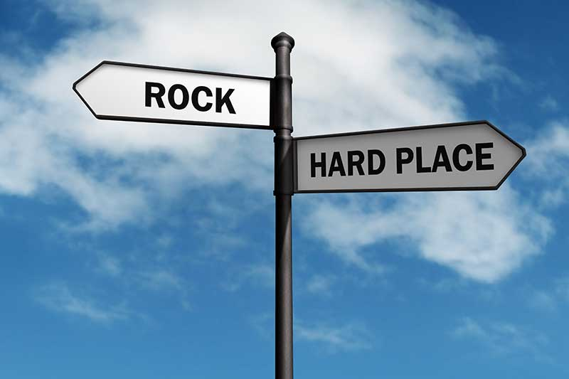 between a rock and a hard place (Idiom)